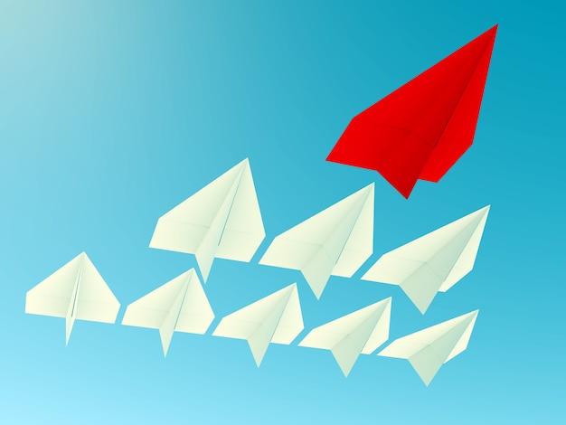 Концепция лидерства. один красный самолет-лидер ведет вперед другие синие самолеты.