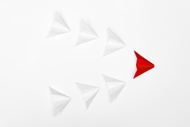 Leadership concept. red paper airplane leading whites