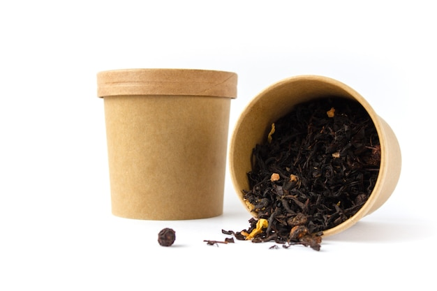 Leaf black tea in a round carton isolated with white background. zero waste concept