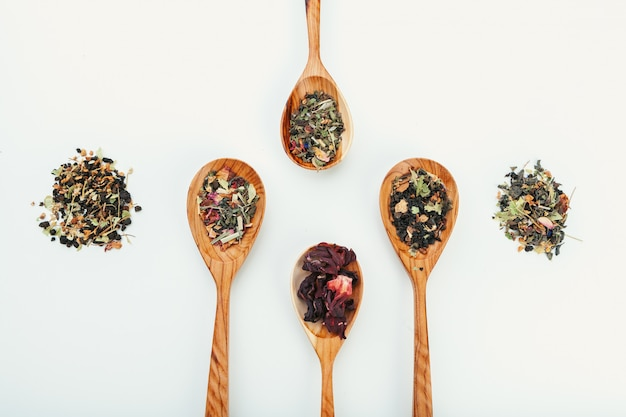 Leaf  tea in a wooden spoon isolated
