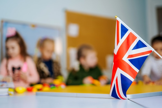 Learn english school children. education in the united kingdom. flag of great britain.