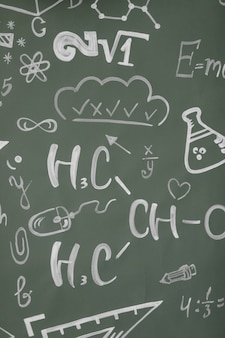 Learning concept. back to school. background with inscriptions from the school course. formulas are written on a chalk board.