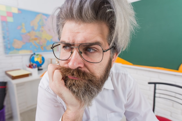 Learning education school concept teachers day beared man teacher in classroom school advertising