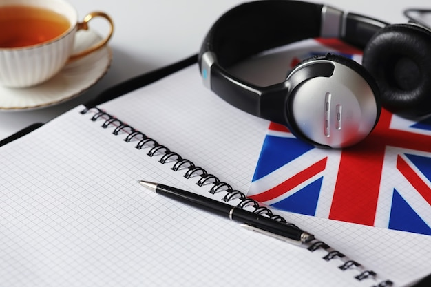 Learning foreign languages. notepad for entries and a flag. language courses, audio audition.