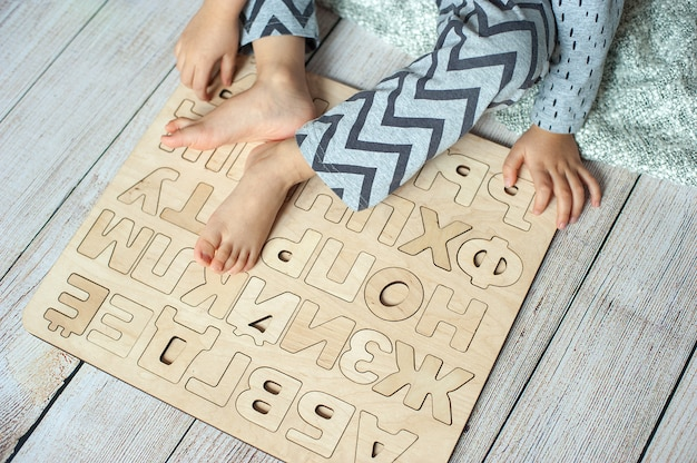 Learning letters. russian alphabet. wood abc. learning fun childhood imagination education
