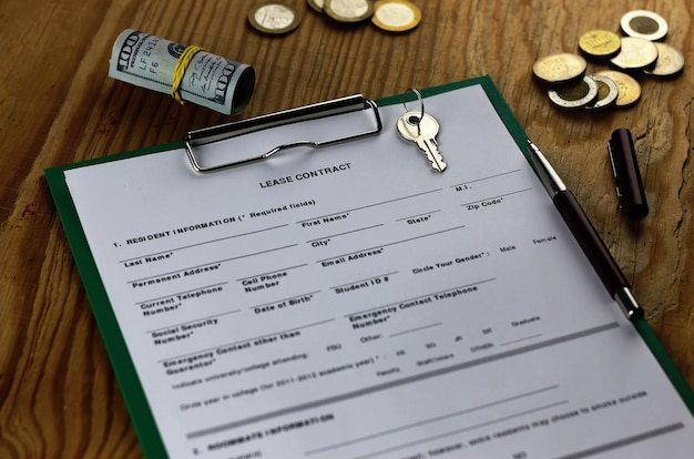 Lease agreement moneyand key on wood table