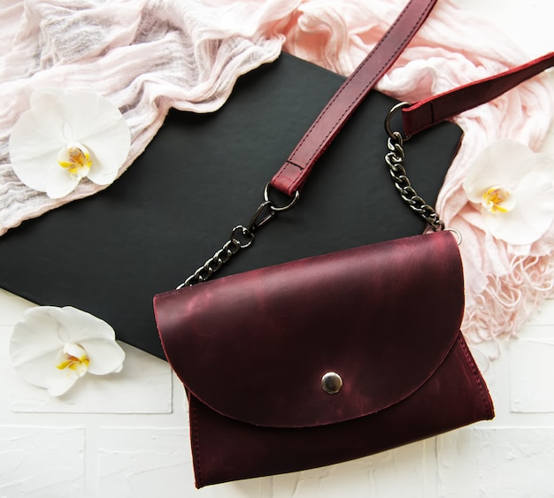 Leather bag and flowers