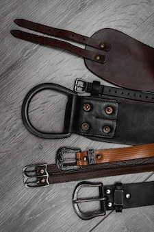 Leather belts on table