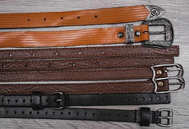 Leather belts on the table