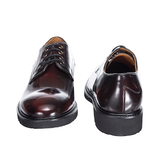Leather classic men's shoes with laces, brown from polished leather, isolated on a white surface