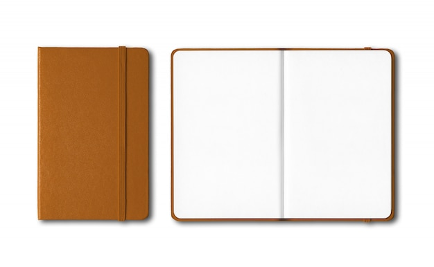 Leather closed and open notebooks isolated on white