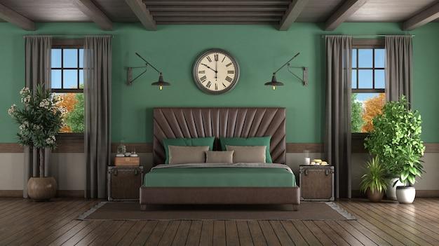 Кожаная двуспальная кровать в зеленой комнате с двумя деревянными окнами