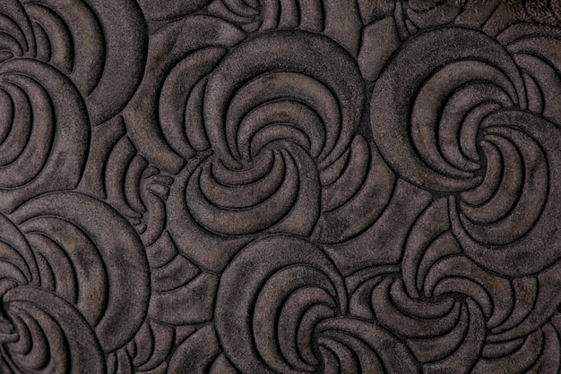 Leather grey floral pattern background close up