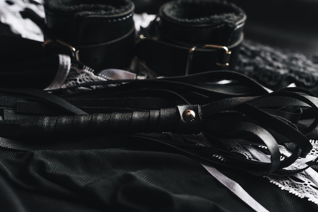 Leather handcuffs and whip for bdsm and maid costume