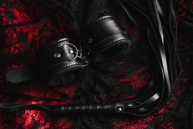 Leather handcuffs and whip for bdsm role-playing sex games