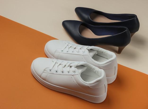 Кожаные туфли на высоком каблуке и кроссовки на цветном планшете