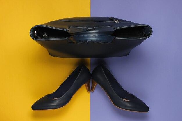 Кожаные туфли на высоком каблуке, сумка на фиолетово-желтой пастели