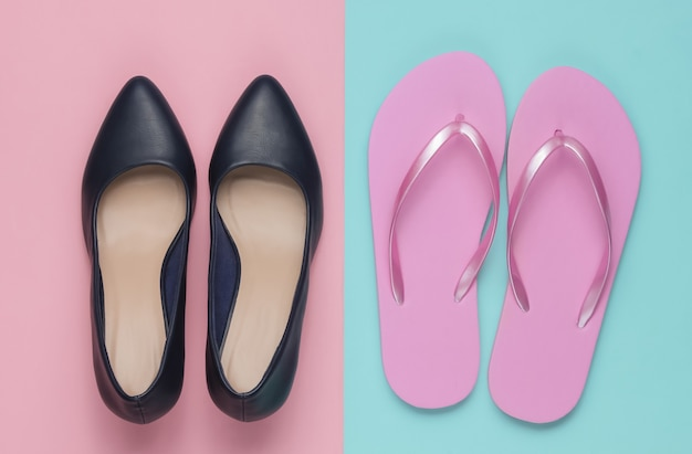 Leather high heel shoes and flip flops on a colored paper