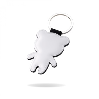 Leather key ring in bear shape on isolated white background.
