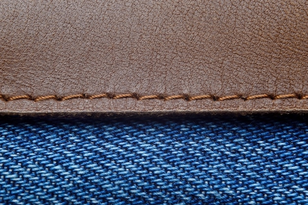 Leather label on blue jeans close-up