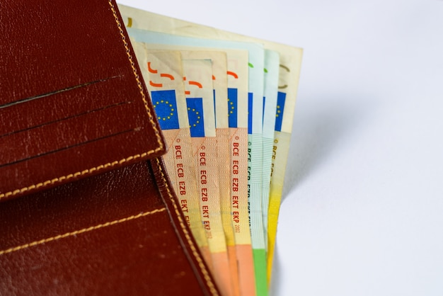 Leather men's open wallet with euro banknotes bills. very shallow deep of field.