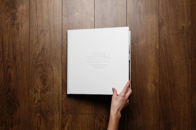 Leather photo book on wooden background
