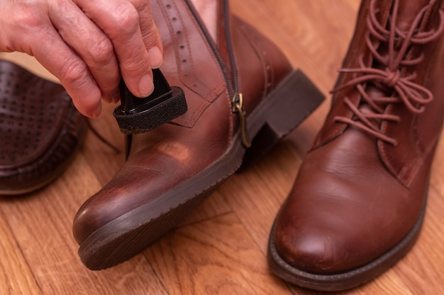 Leather shoe care. applying shoe polish to brown shoes.