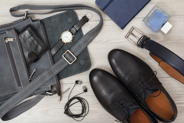 Leather shoulder bag for men with wallet and wristwatch on it mens accessories