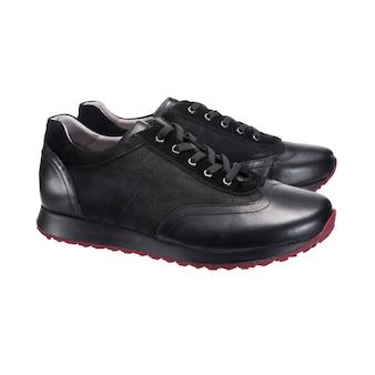 Leather sneakers for men, black sports shoes, sports shoes, clothing accessories isolated on a white surface