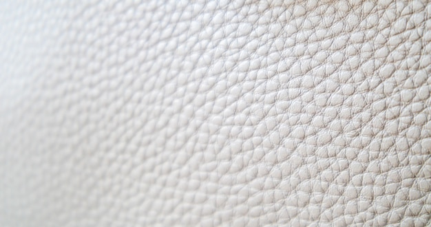 Leather texture background. light beige ecru imitation leather sample. abstract background with copy space, top view.