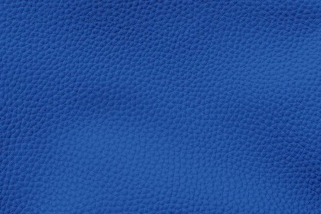 革の質感の濃い青の背景