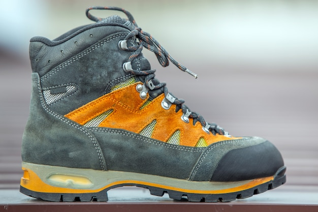 A leather trekking hiking winter boot on blurred