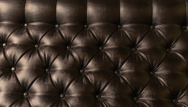 Leather upholstery brown background sofa light shadow