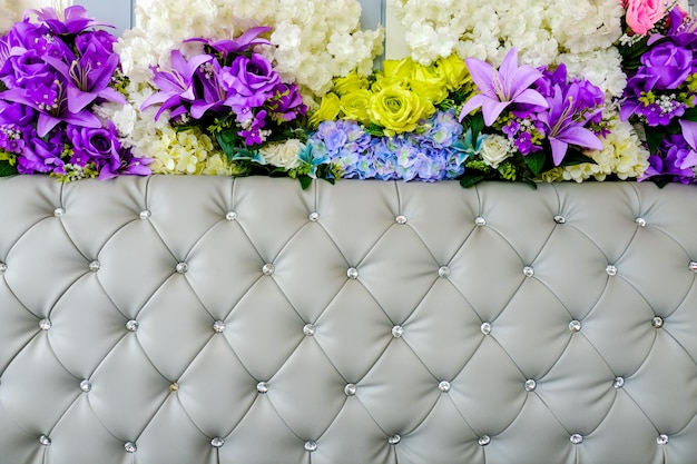 Leather upholstery and flowers background