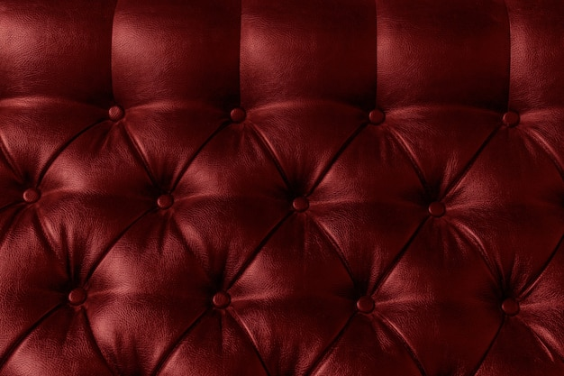 Leather upholstery red vine colour background sofa light shadow