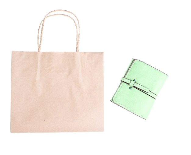 Leather wallet and paper shopping bag isolated