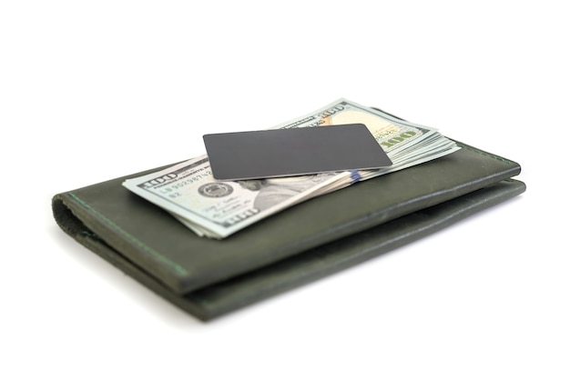 Leather wallet with credit card and us dollars isolated. side view.