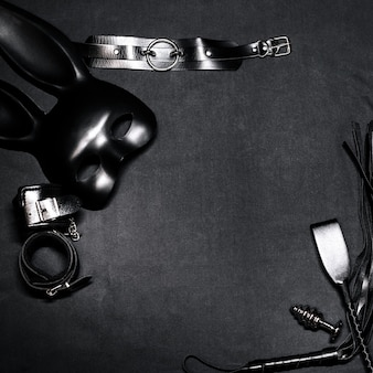 Leather whip, handcuffs, choker, mask and metal anal plug for bdsm sex and role play