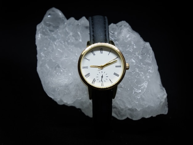 Leather woman watch with diamond on black background
