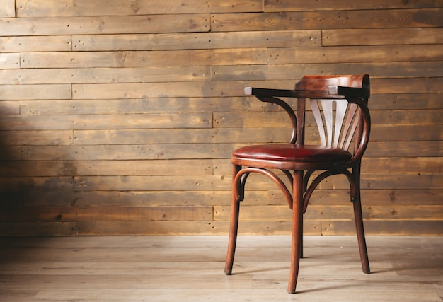 Leather and wooden chair on an old wooden background