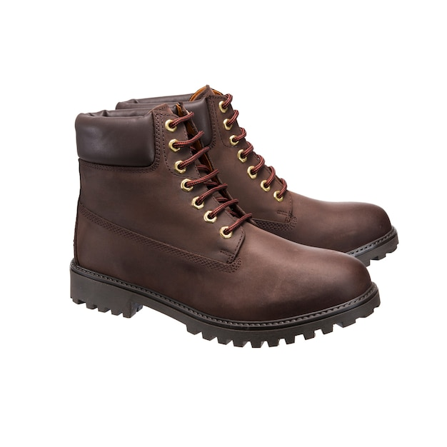 Leather work boots with lace-up tread pattern for casual wear isolated on a white surface