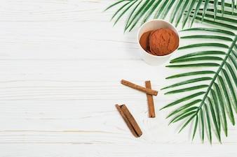 Leaves and cinnamon near ice-cream