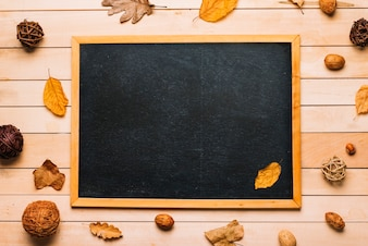 Leaves and decorative balls around blackboard