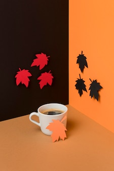 Leaves next to cup of coffee arrangement