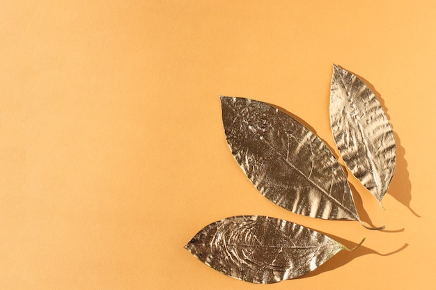 Leaves painted in gold on orange