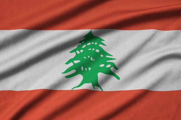 Lebanon flag  is depicted on a sports cloth fabric with many folds.