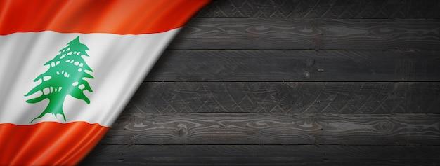 Флаг ливана на черной деревянной стене