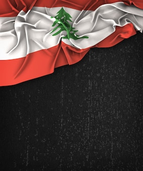 Lebanon flag vintage on a grunge black chalkboard with space for text