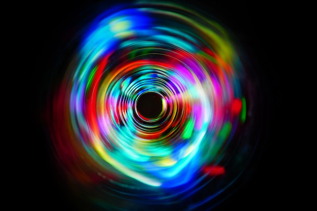 Led color rainbow light moving on long exposure shot in the dark.