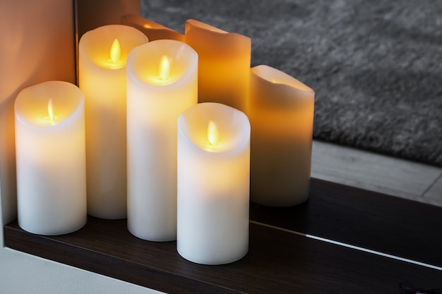 Led electric candles stand in the home
